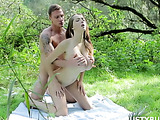 Well-hung lad shags busty babe in doggy style on picnic