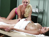 Alluring blonde and brunette in hot pink uniform having a nice vagina pleasuring experience on a massage bed