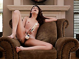 Flat-chested pale brunette rubbing her pussy on a chair