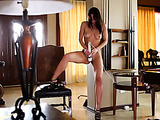 Round booty brunette bent over a round table, masturbating