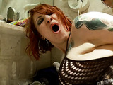 pale skinned tattood slut in black fishnets takes cock in her ass