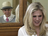 Sexy blonde takes off the fedora and has lesbian sex with another blonde hottie