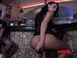 Sexy brunette in black leather dress gets her ass fucked at the bar