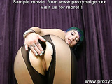 Green-haired teen in black catsuit fisting her pooper and toying with glass dildo