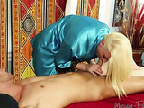 Skilled blonde in bright blue silk robe and black undergarment makes sure she pleasures a dick with her mouth in a massage room