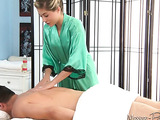 Antalizing blonde wearing green silk robe with black lace details having pretty exotic massage session