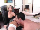 Short-haired blonde in glasses is sucking a boner