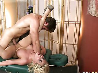 short-haired blonde masseuse fucks