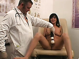 The doctor takes hold of her toy and puts it to some real use