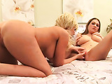 Two stunning blonde bitches with huge tits are eating one another's pussy