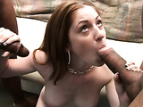 Brown haired slut with massive hooters is sucking two black dicks at once