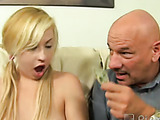 Antalizing blonde wearing white flowery and colorful undergarment having pretty rough sex with few horny guys on the white couch