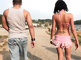 Nasty brunette bitch in pink bikini grabs a drink and rides a speedboat with horny guys