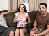 Skinny brunette gets interviewed and slowly strips off her pink shirt to be drilled by two cocks