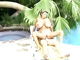 monster tittied asian slut sits on an old cock by the pool