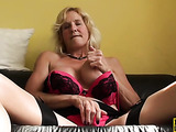 Mature blonde bimbo is in nylons while getting her snatch fingered and fucked