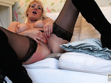 Big titted milf with huge tits is in black stockings while riding cock