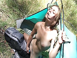 Out in the woods, she gets down on her knees and works her pussy out