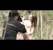 Stripping down, these two lovely ladies take a stroll through the woods nude