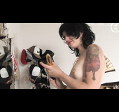 Perched in front of a mirror, she masturbates with a vibrator, watching herself