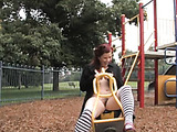 At the park, she squats low and rubs on her hairy pussy