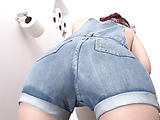 Tatted, with red hair, she drops her pants, confined in a small toilet