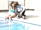 Walking hand in hand around the pool, these lovers smile and enjoy their time