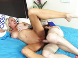 Crazy blonde milf with arm tattoo wears black top exposing her large tits while she sucks on nerd's hard long cock