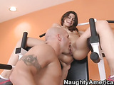 Masculine tattooed trainor takes of skinny brunette's pink workout attire and bra and pounds her while she wears her sneakers