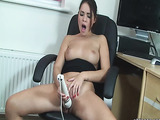 Lounging in a chair, she uses a large, white, vibrator on her pussy
