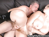 Chubby ginger takes off her black top and exposes her giant natural tits and hairy pussy in teacher's office