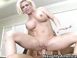 Short haired blonde bombshell with face piercing and colorful dress undresses tattooed guy and gets pounded while pushing her large tits on his chest