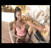 Lusty ebony in pink top and leather boots lets black dude lick her shaved twat after masturbating on the couch
