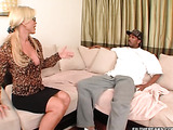 High heeled blonde in glasses and high heels taking off her outfit and seducing younger black dude