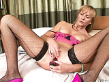 Brunette grandma in fishnet hose dildoing her pussy on the couch and sucking younger guy's cock