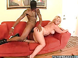 High heeled blonde with big naturals gets her wet fuck hole banged hard by black dude on the red couch