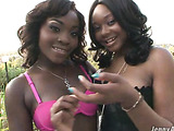 Big breasted ebony in black lingerie and her gf in pink undies kissing outdoors and exposing their big tits