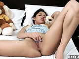 Blue nailed brunette in blue top fingering her shaved fuck hole on the white bed