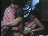 Red lipped babe in red top and grey miniskirt gets her bushy twat licked on the table before being fucked