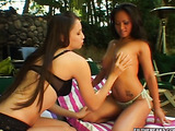 Black haired asian in green undies and her brunette mate undressing one other outdoors and sucking their nipples