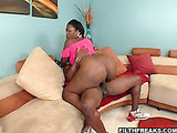 Chubby black gf in high heels and pink top sucking black cock on the couch before riding it