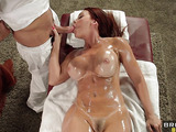 Oiled redhead milf is giving a blowjob for a masseur