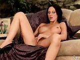 busty brunette jams a pink vibrator in her wet pussy