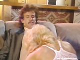 Vintage blonde with perky tits gets fucked from behind and rides on top.