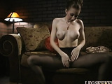 skinny chick peels off her stockings to show her tight pussy
