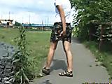 Valeria pisses on asphalt
