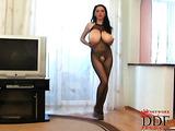 Black fishnet bodysuit brunette with wavy hair masturbates