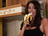 Brown-haired brunette in denim shorts eating bananas suggestively and fucking a guy
