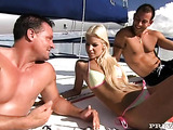 Colorful bikini blonde gets fucked by two hung studs on a boat