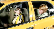 brunette cabbie dressed latex